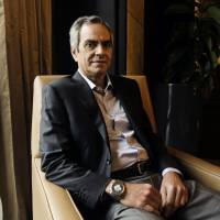 Billionaire Enrique Razon sits for a photograph in Manila on Oct. 2, 2015. Razon is pushing ahead with plans to build a $418 million resort in Manila in expectations of growing demand for upper-end leisure. | BLOOMBERG