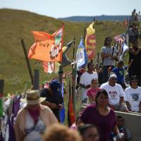 Sioux clash with bulldozer crew resuming oil pipeline work at sacred site
