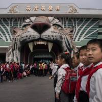 Visitors wait to enter the Museum of Natural History in Pyongyang on Wednesday. | AFP-JIJI