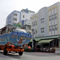 A tourist bus drives by Ocean Drive Thursday in the South Beach area of Miami Beach, Florida. Authorities in Florida said Thursday they have found the Zika virus in three groups of trapped mosquitoes in Miami Beach, the first time this has happened in the continental U.S. | AP