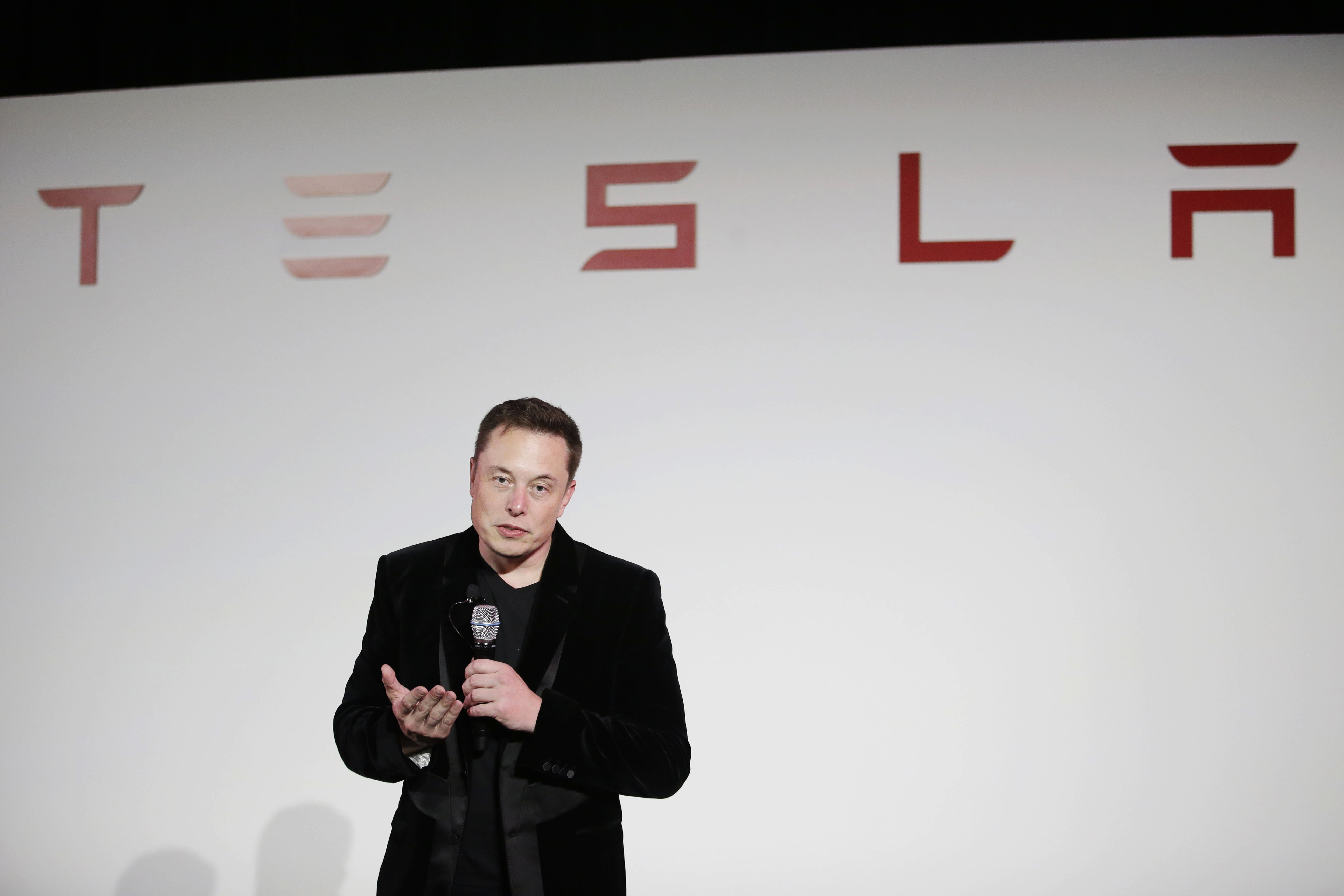 Elon Musk, CEO of Tesla Motors Inc., talks during a news conference at the company's headquarters in Fremont, California, at the end of last September. Musk said Sunday the electric car company is making major improvements to the Autopilot system installed in its vehicles, which will dramatically reduce the number and severity of crashes they're involved in. | AP
