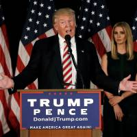Republican U.S. presidential nominee Donald Trump speaks at a campaign event as his daughter Ivanka looks on in Aston, Pennsylvania, on Tuesday. | REUTERS