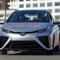 A Toyota Motor Corp. Mirai fuel cell sedan is driven in San Francisco on Nov. 13, 2015. | BLOOMBERG