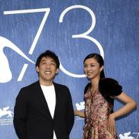 Director Kei Ishikawa (left) and actress Hikari Mitsushima pose during a photo call for 'Gukoroku' ('Traces of Sin') at the 73rd Venice Film Festival in Venice, Italy, Tuesday. | ANSA / VIA AP