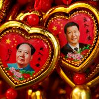 Souvenirs featuring portraits of China's late Chairman Mao Zedong and current President Xi Jinping are seen at a shop near the Forbidden City in Beijing on Sept. 9.   REUTERS