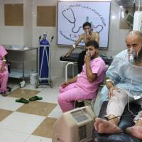 Mostly civilians hurt in chlorine gas barrel bomb attack on Aleppo laid to Syria regime
