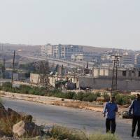 Syrian forces seen withdrawing from key Aleppo road but no aid convoys yet