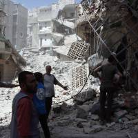 Syria tells Aleppo civilians to keep away from rebel sites as it moves to retake city