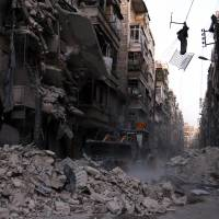 As Russian bombs rain down, Syria army retakes central Aleppo district