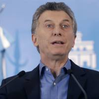 Argentine President Mauricio Macri talks about new poverty numbers released by the National Institute of Statistics and Census, INDEC, during a press conference in Buenos Aires Wednesday. Macri claimed that the previous administration underreported the country's poverty rates. | AP