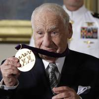 Actor, comedian and writer, Mel Brooks holds up his 2015 National Medal of Arts awarded to him by President Barack Obama during a ceremony in the East Room of the White House Thursday. | AP