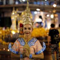 A Thai classical dancer poses for photos at the Erawan Shrine in central Bangkok on Aug. 30. | REUTERS