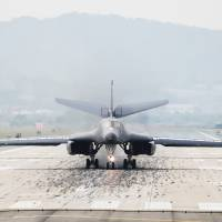 A U.S. Air Force B-1B bomber lands Osan Air Base in Pyeongtaek, South Korea, on Wednesday. | REUTERS