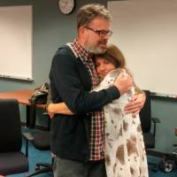 Kevin Garratt, a Canadian held in China for two years on suspicion of spying, hugs his wife, Julia, after arriving back in Vancouver, British Columbia, on Thursday. | GARRATT FAMILY / VIA REUTERS