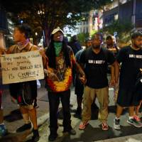 As Charlotte Panthers play in tense city, protests outside remain peaceful