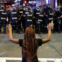 Unrest flares anew in U.S. city after police shooting