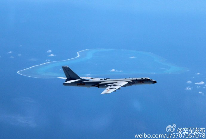 A Chinese H-6K bomber patrols islands and reefs in the South China Sea in this undated photo. | XINHUA NEWS AGENCY / AP