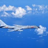 Chinese Air Force announces 'regular' exercises flying through key entryway into western Pacific