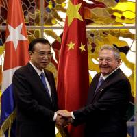 Chinese Premier Li Keqiang and Cuban President Raul Castro meet at Havana's Revolution Palace on Saturday. | REUTERS
