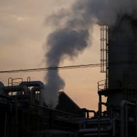 Steam rises from a chemical plant at dusk in the Keihin industrial area in Kawasaki. | BLOOMBERG