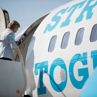 Clinton 'more than ready' for final mad campaign dash, invites press aboard new jet