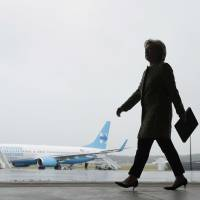 Democratic U.S. presidential candidate Hillary Clinton walks to a podium to speak with members of the media at Westchester County Airport in White Plains, New York, on Monday.   AP