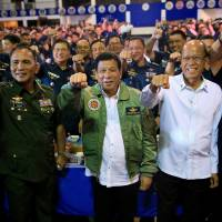 Philippine President Rodrigo Duterte (center) meets with air force personnel during the 250th Presidential Airlift Wing anniversary at the Villamor Air Base in Pasay city, Metro Manila, on Sept. 13. | REUTERS