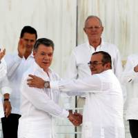Colombia, FARC sign historic peace deal ending half-century of armed conflict