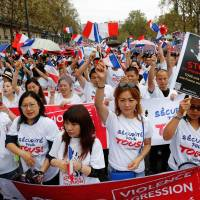Following fatal mugging incident, ethnic Chinese demand 'security for all' in Paris protest