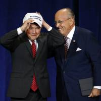 Former Mayor of New York CIty Rudy Giuliani gives U.S. Sen. Jeff Sessions a 'Make Mexico Great Again Also' hat prior to Republican presidential candidate Donald Trump's speech during a campaign rally at the Phoenix Convention Center Wednesday in Phoenix. | AP
