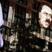 Artist's huge Hitler apparition on Berlin building prompts call for cops
