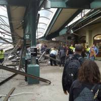 Commuter train crashes into New Jersey station; more than 100 injured