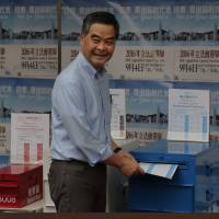 Hong Kong votes in test of China's influence over regional financial hub