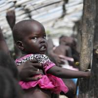 Displaced South Sudanese line up for food at a U.N. camp in Juba on July 25. The U.N. says hunger in South Sudan is at 'unprecedented' levels, affecting nearly 5 million people. | AP