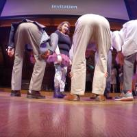 Scientists demonstrate a different perspective by peering between their legs at the 2016 Ig Nobel award ceremony Thursday at Harvard University. Professors Atsuki Higashiyama and Kohei Adachi won the perception prize for their research, presented in the paper 'Perceived size and perceived distance of targets viewed from between the legs: Evidence for proprioceptive theory.' | IMPROBABLE RESEARCH: www.improbable.com