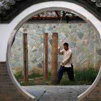 Kung fu master Xing Xi practices at his Kung Fu Zen academy in Beijing at the end of June. | REUTERS
