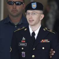 U.S. Army Private First Class Bradley Manning departs the courthouse at Fort Meade, Maryland, in 2013. Manning is a transgender who now goes by the name Chelsea. | REUTERS