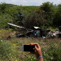 Mexico hunts suspected drug cartel members who shot down police chopper