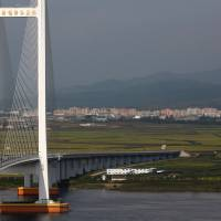 The unfinished New Yalu River Bridge that was designed to connect China's Dandong New Zone and North Korea's Sinuiju, is seen on Sept. 11. | REUTERS