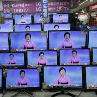 TV screens show a North Korean newscaster reading a statement from the North's Nuclear Weapons Institute during a news program at the Yongsan Electronic Market in Seoul on Friday. | AP