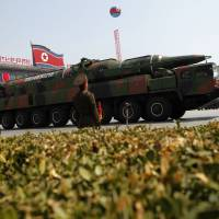 A North Korean vehicle carrying an apparent new missile passes by during a mass military parade in Pyongyang's Kim Il Sung Square during celebrations marking 100 years since the birth of the country's late founder, Kim Il Sung, on April 15, 2012. | AP