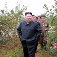 North Korean leader Kim Jong Un gives field guidance to the Kosan Combined Fruit Farm in this undated photo released by North Korea's Korean Central News Agency (KCNA) in Pyongyang Sunday. | KCNA VIA REUTERS