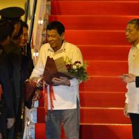 Philippine President Rodrigo Duterte arrives at the Wattay International Airport in Vientiane on Monday for the 28th Association of Southeast Asian Nations (ASEAN) Summit to be held from Tuesday to Thursday. | AFP-JIJI