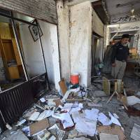 Pakistan hit by attack on Christian colony and by bombing of court