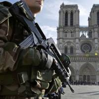 Paris opens terror probe, holds pair after gas canisters found in car near Notre Dame