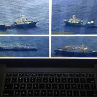 Photographs of apparent Chinese coast guard ships and barges at the disputed Scarborough Shoal in the South China Sea were released by the Philippine government just hours before the Chinese premier attended a summit with Southeast Asian leaders on Wednesday. | AP
