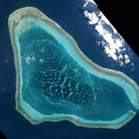 Scarborough Shoal in the disputed South China Sea is seen in March. | PLANET LABS / VIA REUTERS