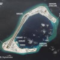 Construction os seen on Subi Reef in the Spratly Islands of the disputed South China Sea in this July 24 satellite image. | CSIS ASIA MARITIME TRANSPARENCY INITIATIVE / DIGITALGLOBE / VIA REUTERS