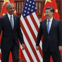 U.S. President Barack Obama and Chinese President Xi Jinping look at each other after shaking hands before a bilateral meeting at West Lake State Guest House in Hangzhou in eastern China's Zhejiang province, on Saturday. | AP