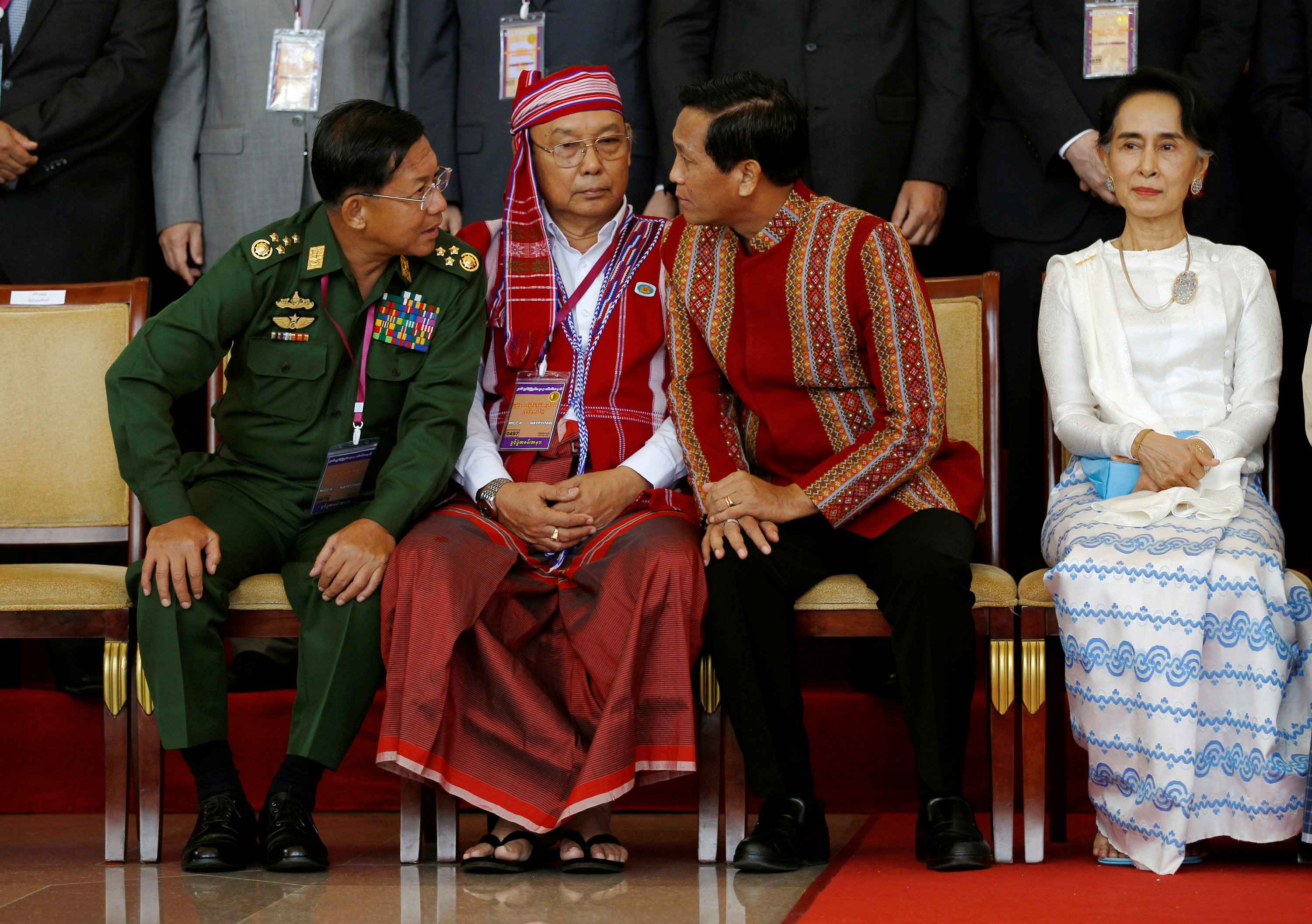 Myanmar commander in chief Senior Gen. Min Aung Hlaing (left), parliamentary upper house Speaker Mahn Win Khaing Than (second from left)and Vice President Henry Van Thio chat next to State Counselor Aung San Suu Kyi after the opening ceremony of the 21st Century Panglong Conference in Naypyitaw on Wednesday. | REUTERS